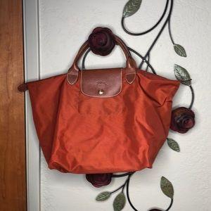 Long champ Small Rust handle bag